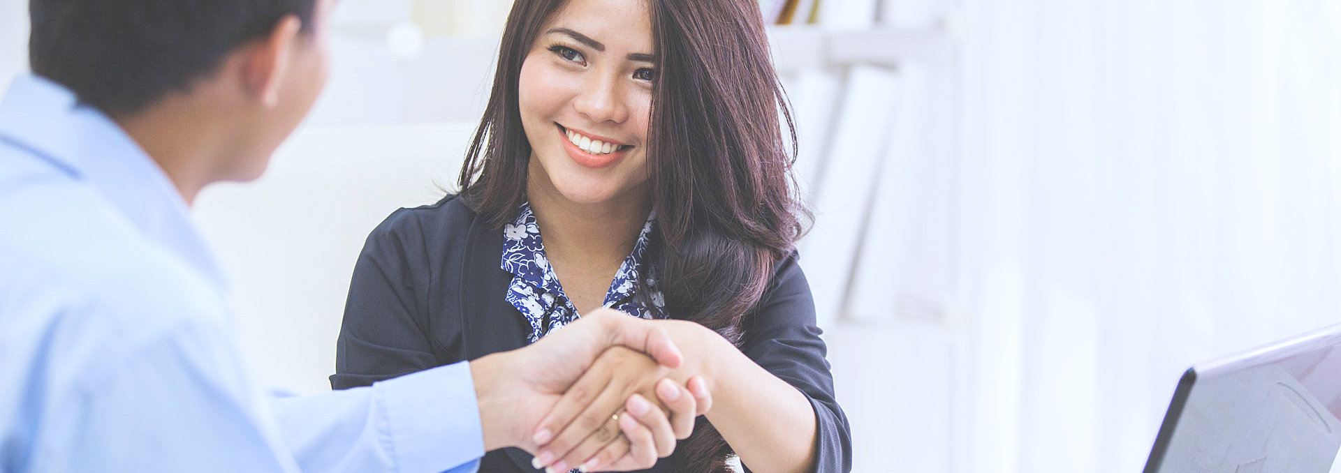 client shaking her agent hand