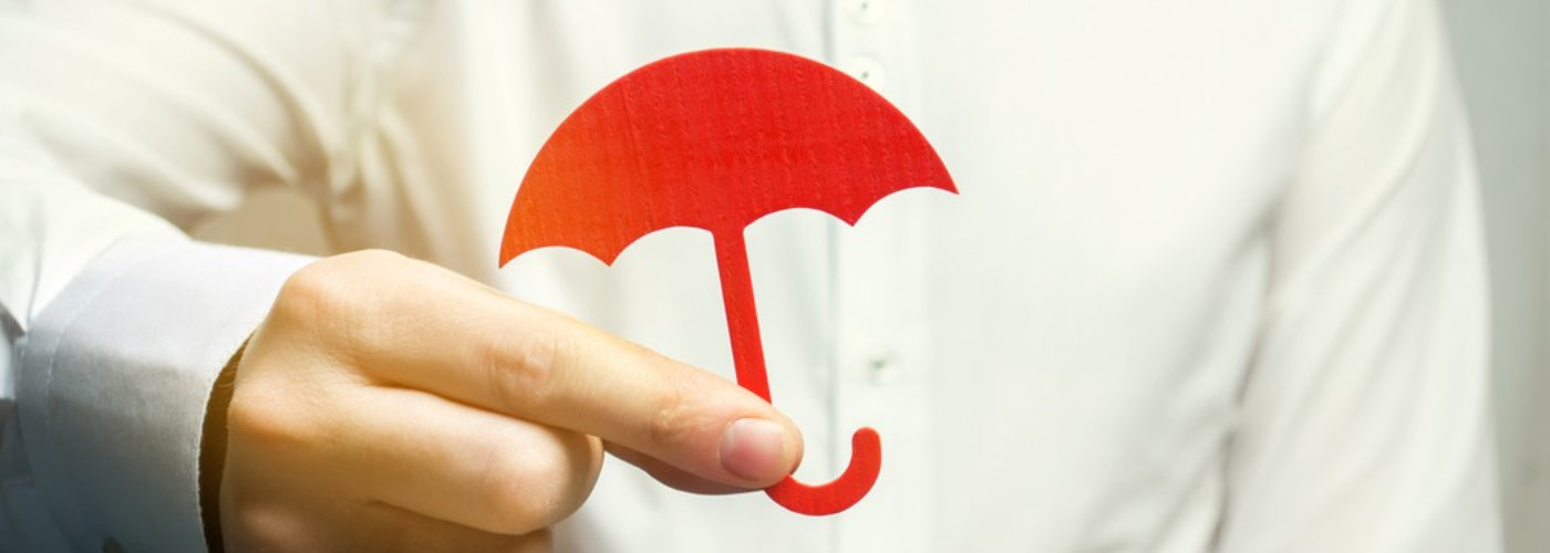 man holding an umbrella toy